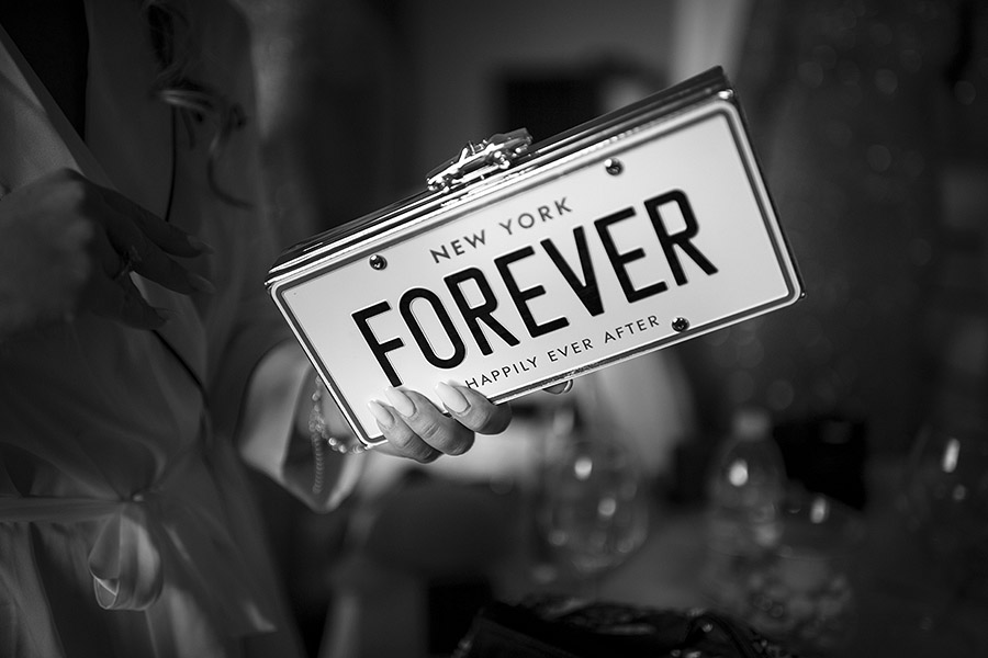 Nice photo to a car license plate with Forever written on it, Meleto Castle wedding. Andrea Corsi photographer
